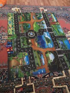 Žaidimų kilimėlis su miesto vaizdais photo review
